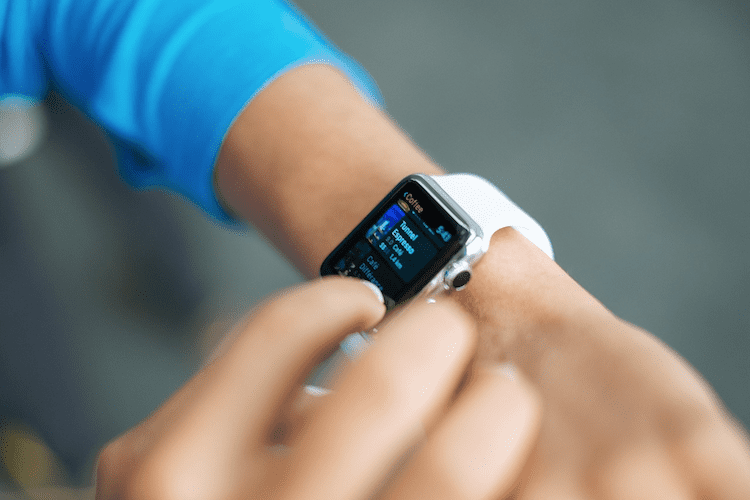 Woman checking her smart watch.
