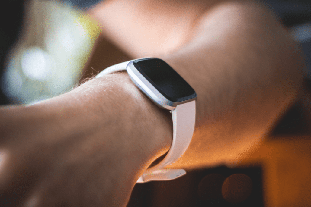 Person wearing smart watch to monitor activity and health