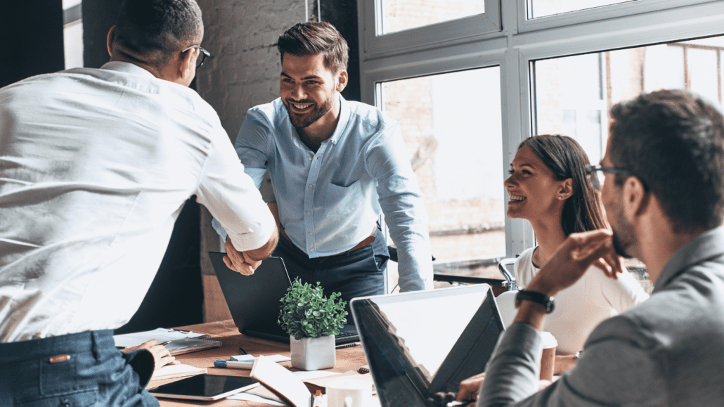 Image showing group insurance salespeople shaking hands